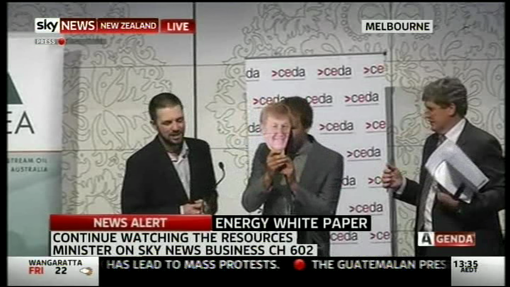 VIDEO: Australian press conference taken over by singing protesters