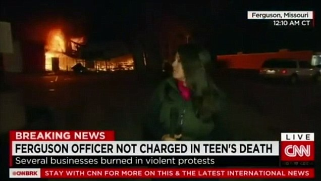 CNN Reporter gets hit by rock live on TV